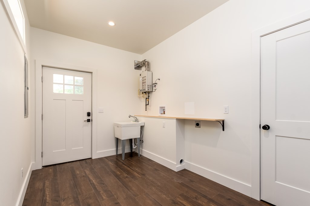 Laundry room featuring whole house tankless water